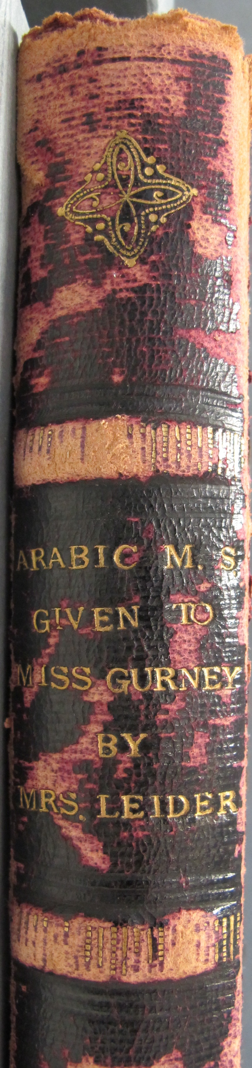 """Spine imprinted: """"ARABIC M.S. GIVEN TO MISS GURNEY BY MRS. LEIDER"""""""