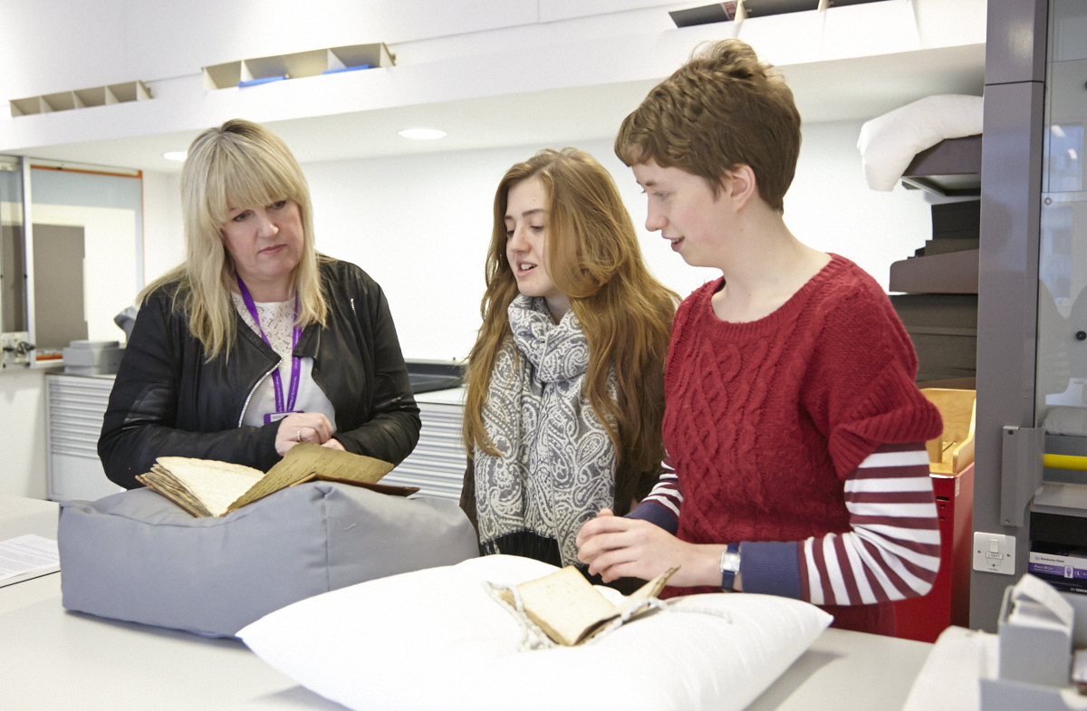 MA History of the Book Students Izzy and Jenny with Collection Care Manager Caroline Checkley-Scott in The John Rylands Library's conservation studio